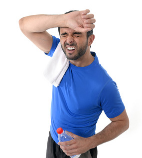 athletic sport man  holding water bottle wiping out sweat after