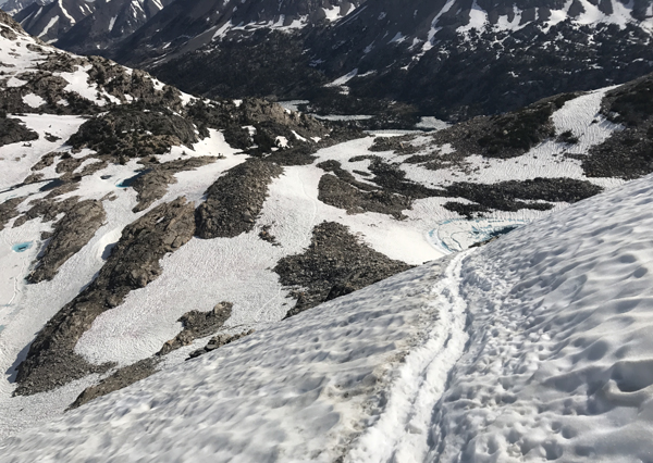 Glen Pass. If you slipped and fell here that would be very, very bad. Ice axe and crampons = required equipment