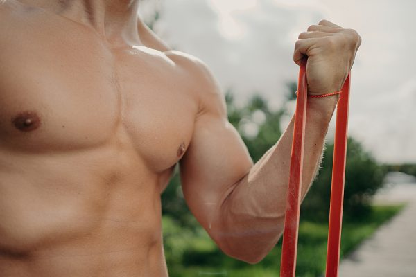 Man doing bicep curl with resistance band